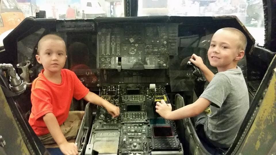 Kids in cockpit - naval aviation museum